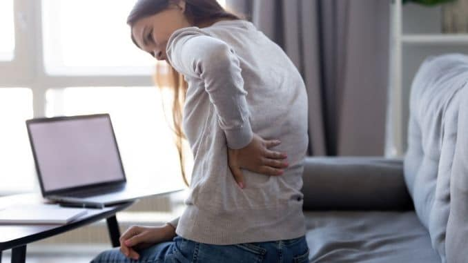Young woman feeling backpain