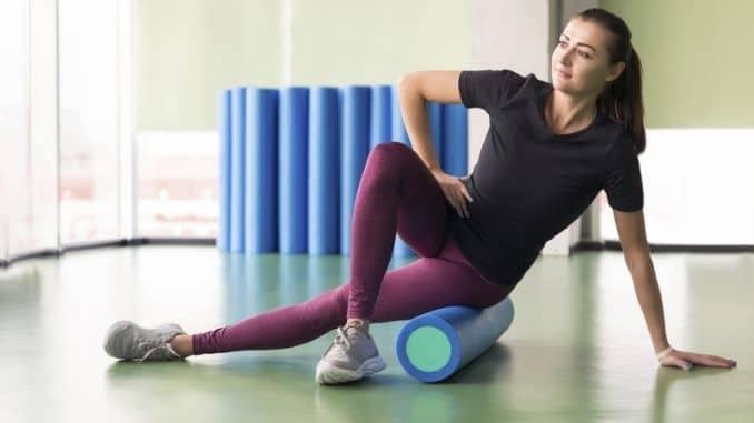 female doing foam roller exercise