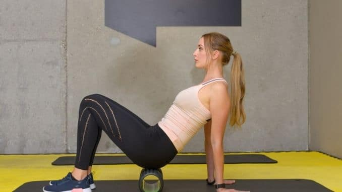 woman exercising with roller
