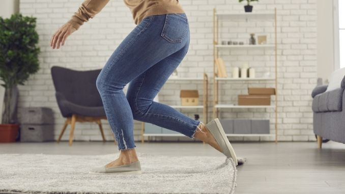 woman trips over the rug