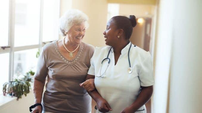 nurse-assisting-senior-woman