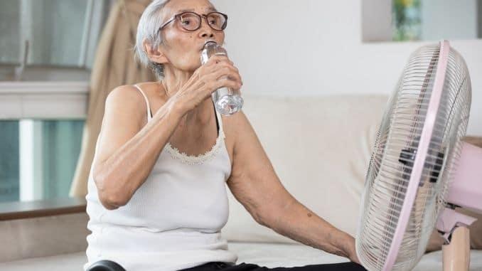 elderly-woman-drinking-bottle