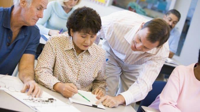 teacher-assisting-mature-student