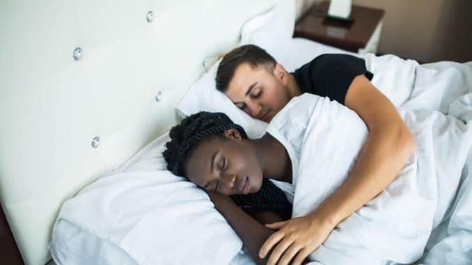 couple-sleeping-together